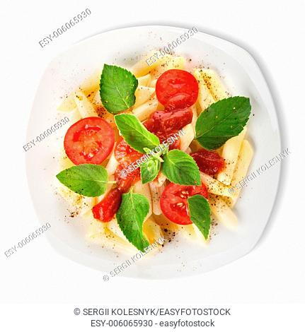 Pasta with ketchup and tomatoes isolated on a white background