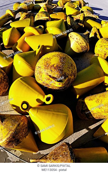 Heap of yellow buoy at quay, Marseille, France