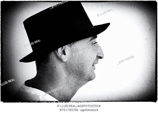 Profile Portrait of man with black hat