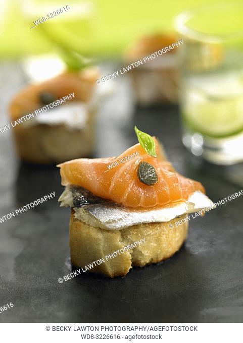 montadito de boqueron y salmon ahumado / montadito of boqueron and smoked salmon