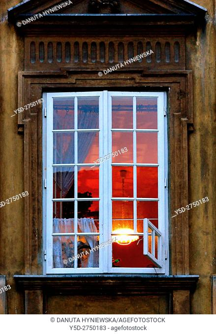 Outside-in looking into a warm family home, old town of Old Town of Warsaw, Poland, Europe