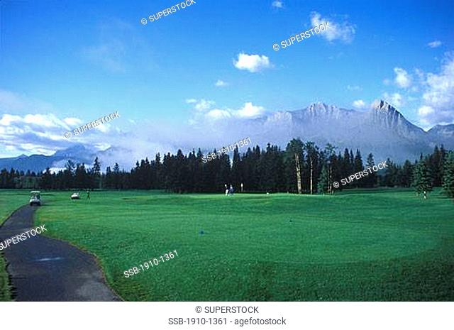 Canmore Golf Course and Three Sisters Mountain behind CANADA Alberta