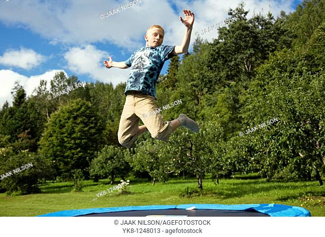 Teenage Boy Jumping on Trampoline