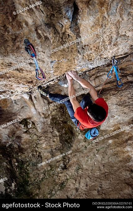 Aerial view of a climber on a hard sport climbing route in a cave