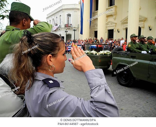 Cubans line the street to honour the recently deceased revolutionary leader of the small Caribbean islandFidel Castro in Santa Clara, Cuba, 01 December 2016