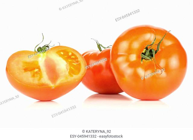 Two red tomato one half isolated on white background