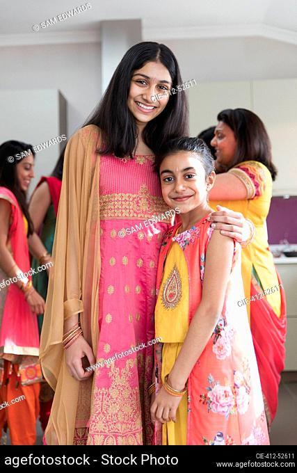Portrait happy Indian sisters in saris