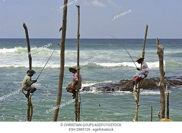 false stilt fishermen, imitating what was this traditional method, posing for the tourists against remuneration, Weligama, South coast, Sri Lanka