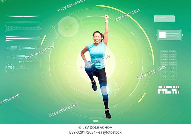 sport, fitness, technology, motion and people concept - happy smiling young woman jumping in superhero pose over white background