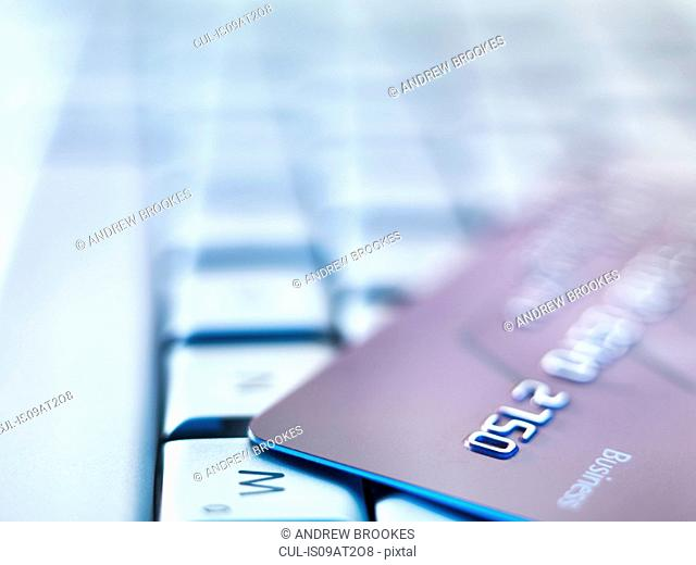 Business credit card on laptop keyboard