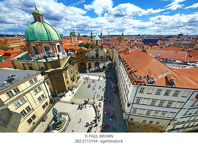 St Francis of Assisi Church and rooftops of the Prague city skyline in the Czech Republic