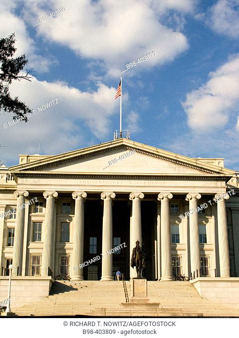 Building of US Treasury Deptartment and statue of Alexander Hamilton. Washington DC. USA