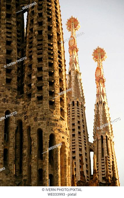 Detail of bell towers of the Sagrada Familia (Church of the Holy Family) by Gaudí, Barcelona. Catalonia, Spain