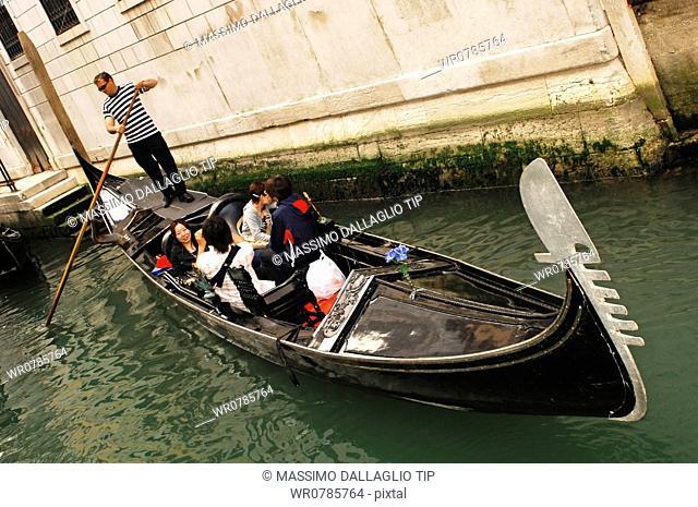 Italy, Venice, Gondola with tourists