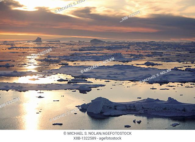 Sunset on fresh sea ice and tabular icebergs in the Weddell Sea, antarctica