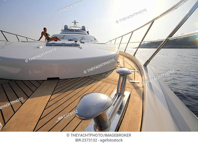 Foredeck, Leonardo II, a cruiser built by Azimut, type of boat: Leonardo 98, length: 30.15 m, built in 2004, a young woman wearing a bikini sitting on the...