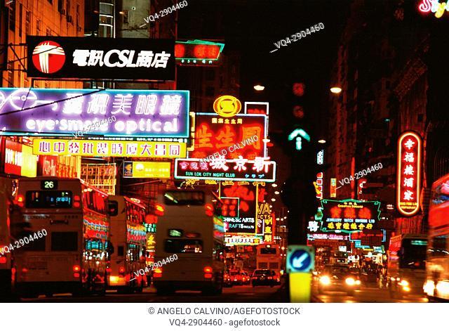 Illuminated neon street signs at night in Nathan Road, Kowloon, Hong Kong, China, Asia