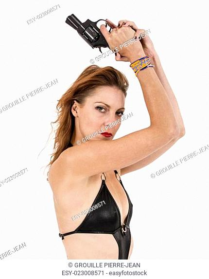 beautifull woman in sensual black dress isolated on studio playing with two guns