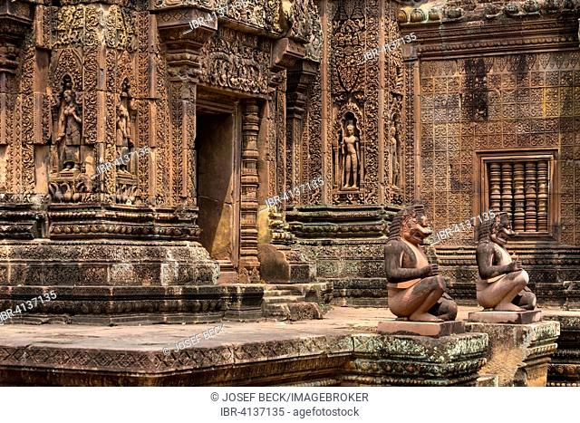 Guardian figures in front of Mandapa and the southern Prasat, Khmer Hindu temple Banteay Srei, Angkor region, Siem Reap Province, Cambodia