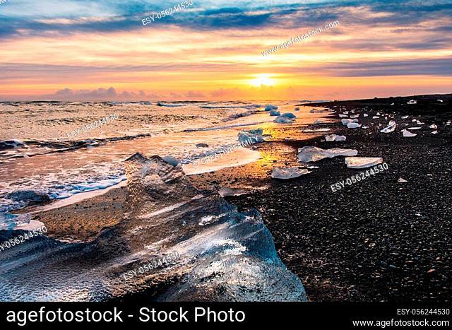 Waves splashing on Diamond beach in Iceland during sunset
