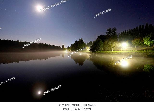 France, Burgundy, Yonne. Saint Sauveur in Puisaye. The pond of Joumiers by night, in lunar atmosphere