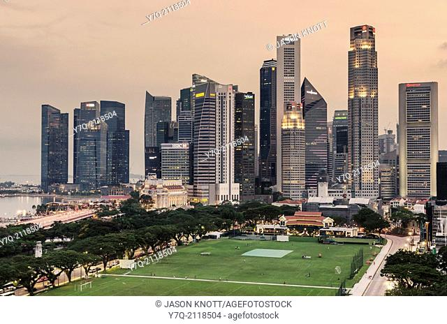 Singapore Downtown Core skyline overlooking The Padang sporting field