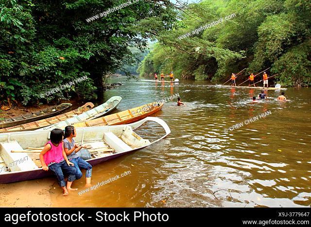 Children playing by the river, Padawan, sarawak, malaysia, borneo