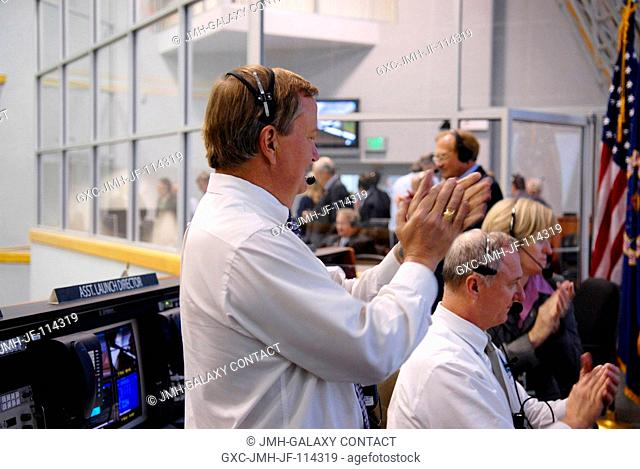 In Firing Room 4 of NASA Kennedy Space Center's Launch Control Center, shuttle launch director Michael Leinbach (standing)