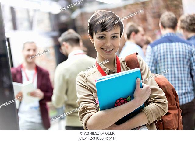 Portrait smiling female college student with backpack and laptop