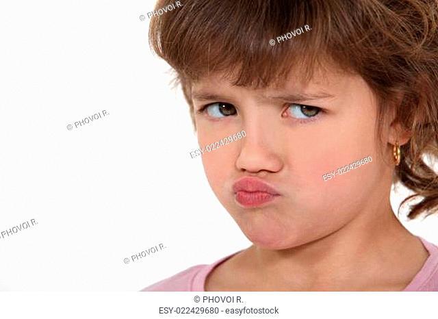 A little girl sulking