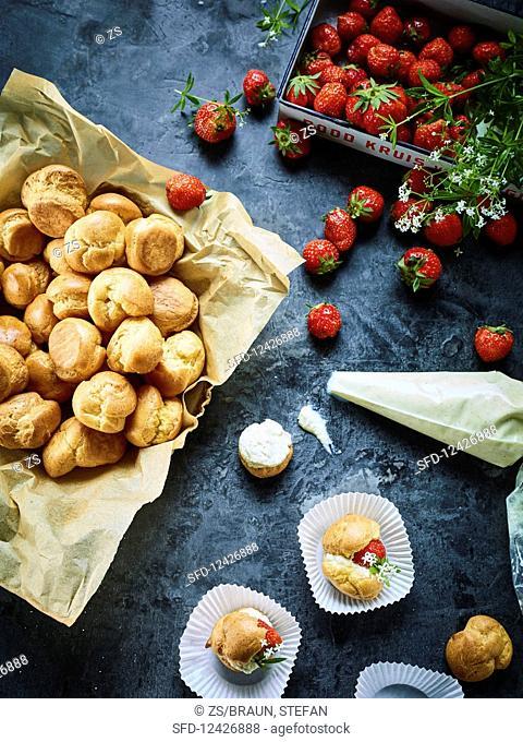 Profiteroles with strawberries and vanilla cream