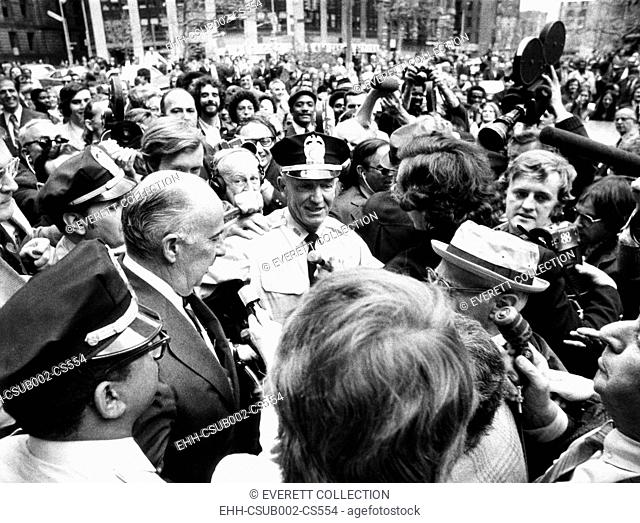 Former Atty. Gen. John Mitchell was escorted by police from New York's Federal Court. April 24, 1973. He testified before a grand jury about a $200