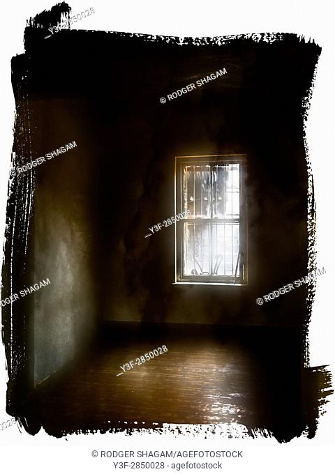 Interior of an old, empty house, grimy sash window, oregon pine floors, eerie light