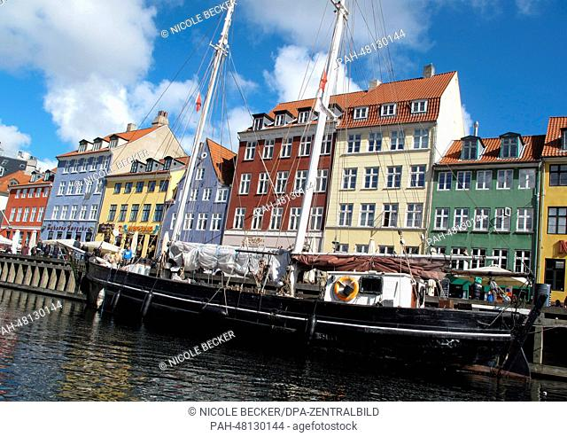 Boats are moored in the Nyhavn canal in Copenhagen, Denmark, 18 April 2014. Nyhavn is a 17th-century waterfront, which is lined by brightly coloured 17th and...
