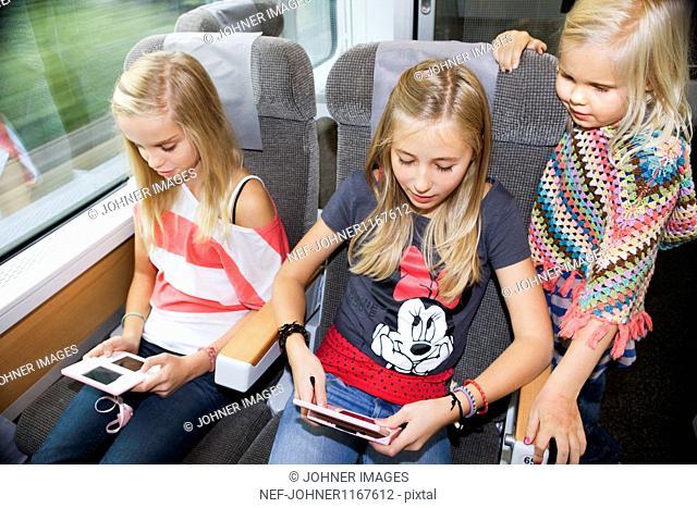 Girls traveling on high speed train