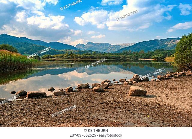 Still,Calm Lake,Mirrored Mountain Relections,Elterwater reflecting The Langdale Pikes,English Lake District,National Park,Cumbria