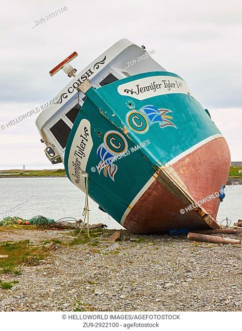 Newfoundland and Labrador flag painted on a rusting fishing trawler, Newfoundland, Canada