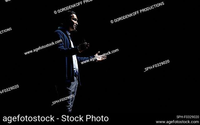 Speaker on stage at conference