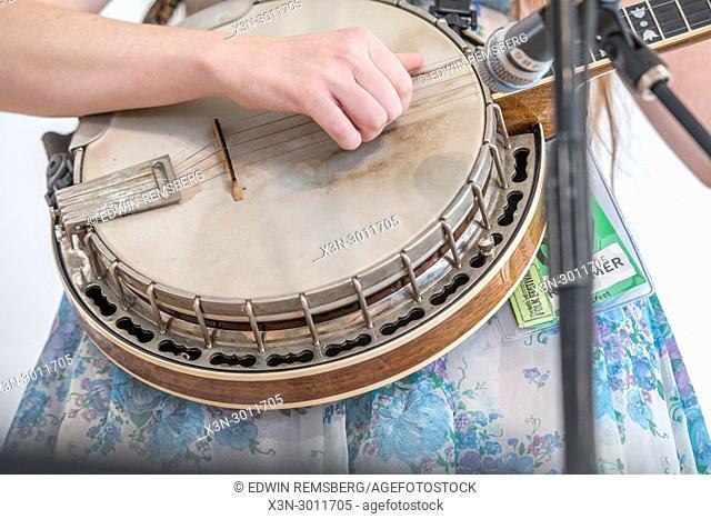 Detailed look at hand strumming strings of banjo, Greensboro, North Carolina. USA