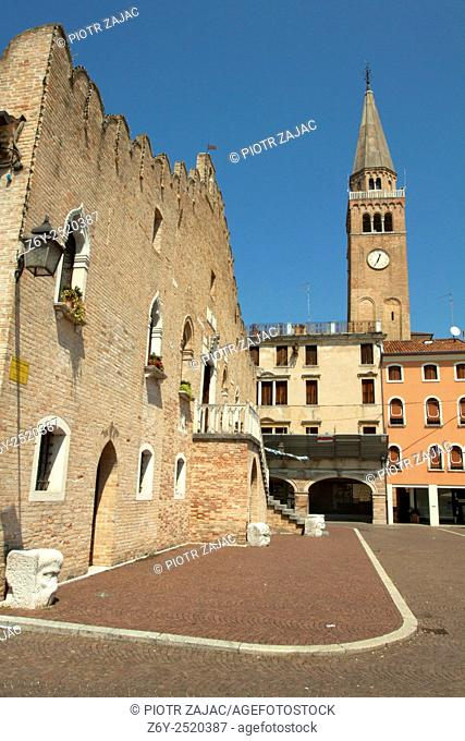 The Town Hall at Piazza della Repubblica and the bell tower of Duomo di Sant'Andrea Apostolo in Portogruaro, Italy