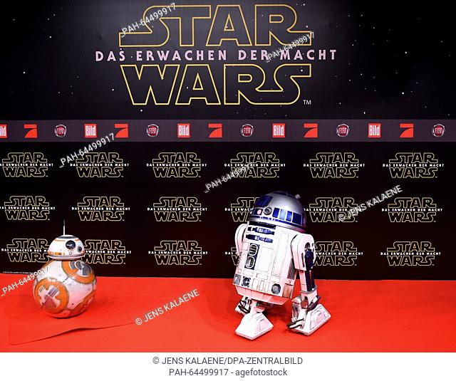 BB-8 und R2D2 (r) from the Star Wars films pose on the red carpet at the Zoo Palast in Berlin, Germany, 16 December 2015