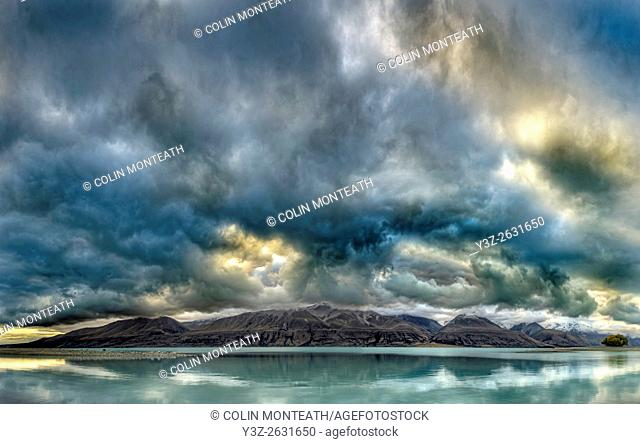 Cloudscape panorama at dusk over Ben Ohau Range, Lake Tekapo, Mackenzie country, Canterbury, New Zealand
