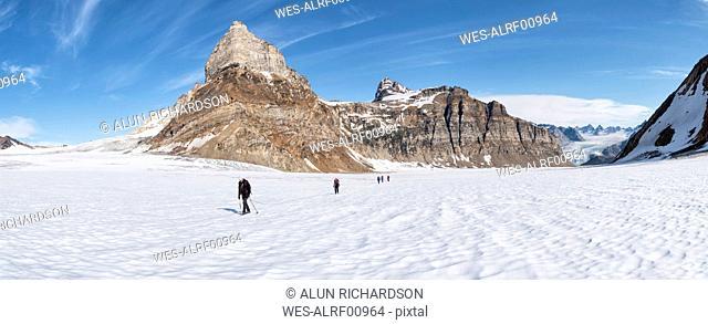 Greenland, Sermersooq, Kulusuk, Schweizerland Alps, group of people walking in snow