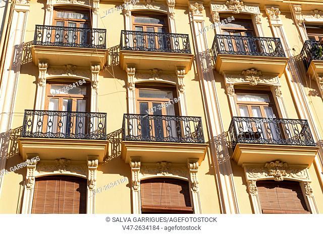 Balconies of a facade of a historic building in the neighborhood ruzafa in Valencia, Spain, Europe