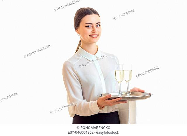 Cheerful girl waitress in uniform smiling isolated on white background