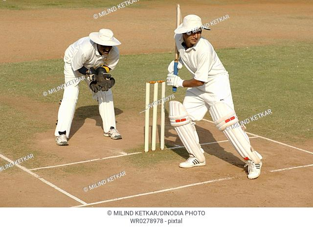 Indian right handed batsman in action playing shot in cricket match MR705L