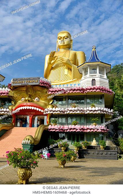 Sri Lanka, Central Province, Matale District, Dambulla, Buddha's huge statue covered with gold leaves and dominating the entered of the temple