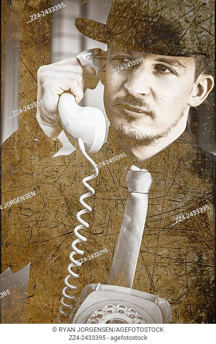 Tatty and worn image of a retro secret intelligence operative in black suit talking on the rotary telephone. A call of interception