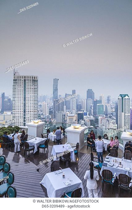 Thailand, Bangkok, Riverside Area, visitors to The Breeze Restaurant at the Lebua Hotel, dusk, NR