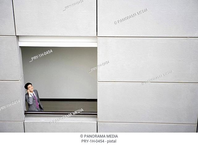Businessman talking on mobile phone, elevated view